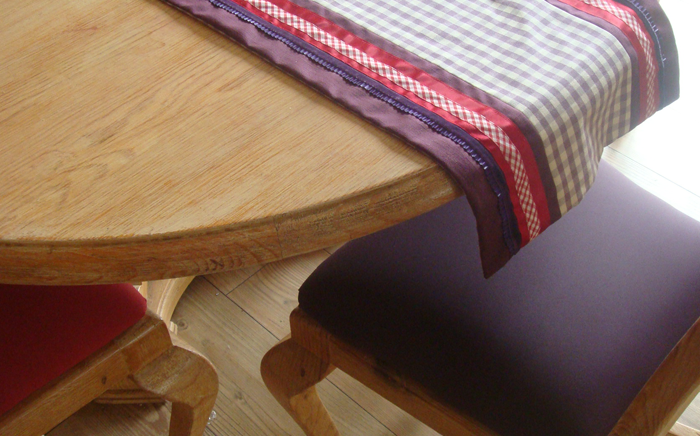 Re-upholstered seat pads and table runner