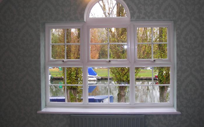 Wallpapered undressed window